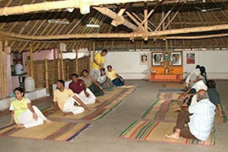 "<div style=""font-family: catamaran; color:#ffffff"">Sivananda Yoga Vedanta Centre</br><span style=""font-size: .8em"">Madurai, Tamil Nadu | India</span></div>"