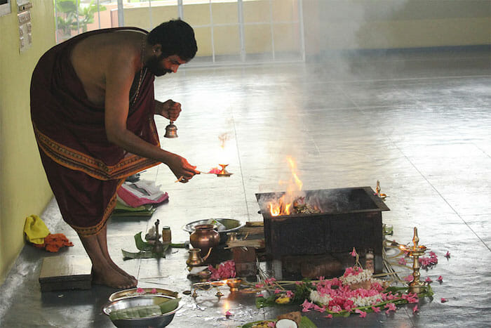 "<div style=""font-family: catamaran; color:#ffffff"">Sivananda Yoga Vedanta Centre</br><span style=""font-size: .8em"">Thiruvananthapuram, Kerala | India</span></div>"