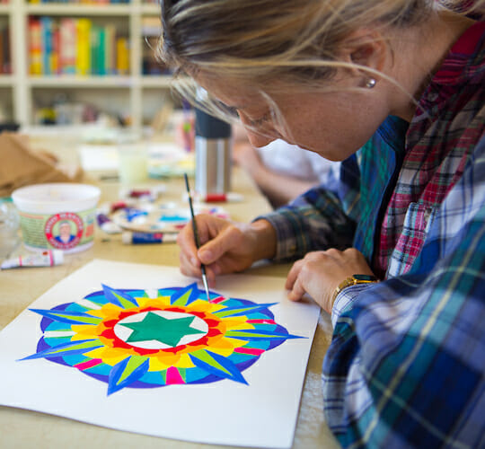 """<div style=""""line-height: 1.3; color: #FF9031; font-family: catamaran;"""">Yantra Painting Workshop</div>"""